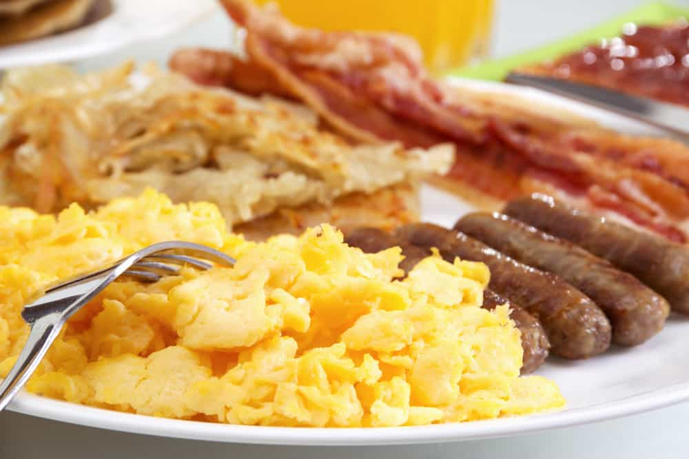 Stock image of hearty breakfast, focus on foreground.